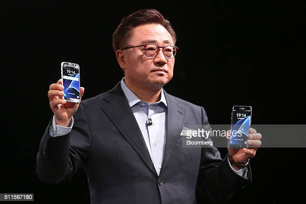 Koh Dong Jin president of mobile communications at Samsung Electronics Co holds the Galaxy S7 smartphone left and the Galaxy S7 Edge smartphone at...