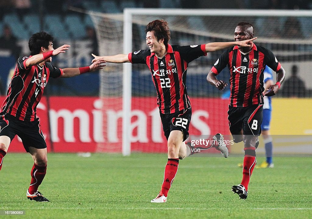 Koh Myong-Jin #22 of FC Seoul celebrates after scoring his team's first goal during the AFC Champions League match between Jiangsu Sainty and FC Seoul at Nanjing Olympic Sports Center Stadium on April 24, 2013 in Nanjing, China.