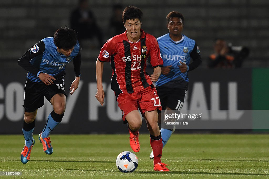 Koh Myongjin #22 of FC Seoul in action during the AFC Champions League Round of 16 match between Kawasaki Frontale and FC Seoul at Todoroki Stadium on May 7, 2014 in Kawasaki, Japan.