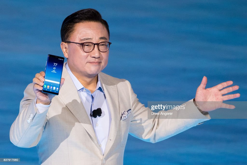 DJ Koh, president of mobile communications business at Samsung, holds up the new Samsung Galaxy Note8 smartphone during a launch event for the new product, August 23, 2017. The Galaxy Note8 will be released in stores on September 15. The previous Galaxy Note 7 model had to be recalled due to self-combusting batteries.
