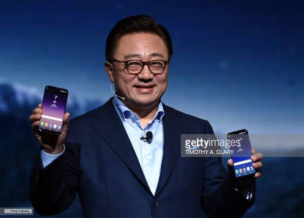 Koh Samsung President Mobile Communications Business introduces the new Samsung S8 and S8 Plus during a news conference on March 29 2017 in New York...