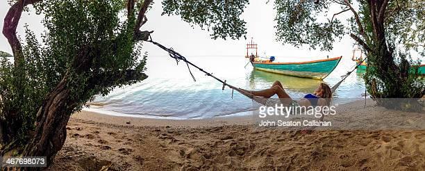 Koh Tonsay, woman in hammock.