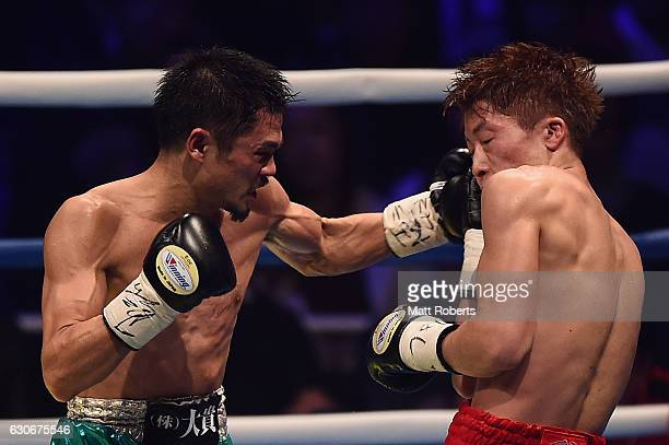 Kohei Kono punches by Naoya Inoue during the WBO World Super Flyweight Title bout between Naoya Inoue and Kohei Kono of Japan at the Ariake Colosseum...