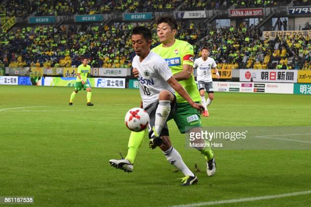 Kohei Kudo of Matsumoto Yamaga and Naoya Kondo of JEF United Chiba compete for the ball during the JLeague J2 match between JEF United Chiba and...
