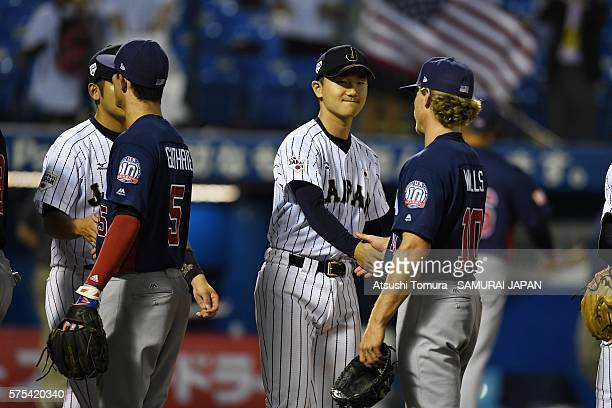 Kohei Miyadai of Japan and Taylor Walls of the USA shake hands on the day 3 match between Japan and USA during the 40th USAJapan International...