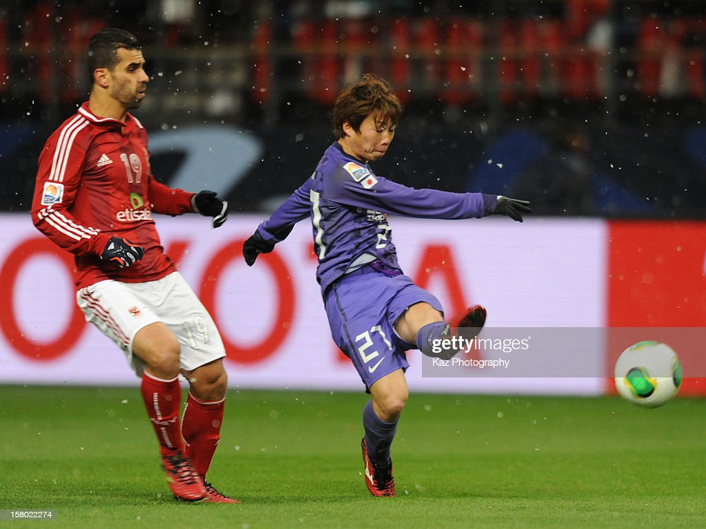 Kohei Shimizu of Sanfrecce Hiroshima shoots the ball under the pressure from Abdalla Said of Al-Ahly SC during the FIFA Club World Cup Quarter Final match between Sanfrecce Hiroshima and Al-Ahly SC at Toyota Stadium on December 9, 2012 in Toyota, Japan.