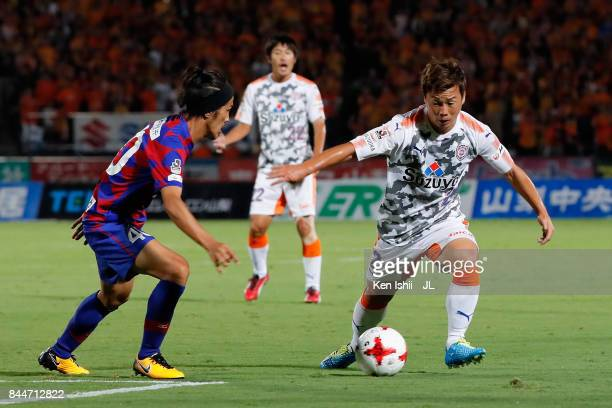 Kohei Shimizu of Shimizu SPulse takes on Shohei Ogura of Ventforet Kofu during the JLeague J1 match between Ventforet Kofu and Shimizu SPulse at...