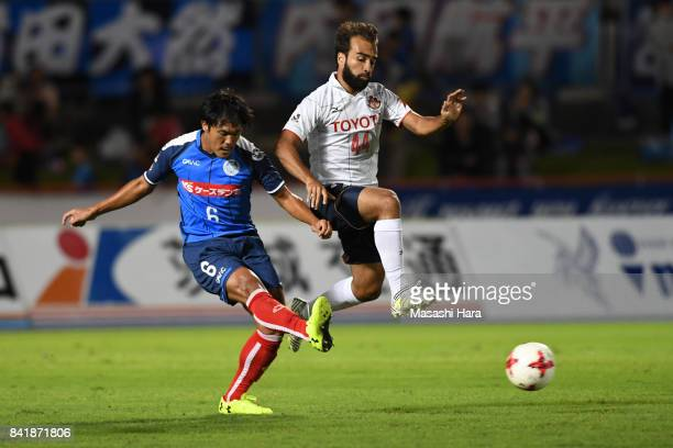 Kohei Uchida of Mito Hollyhock and Gabriel Xavier of Nagoya Grampus compete for the ball during the JLeague J2 match between Mito Hollyhock and...