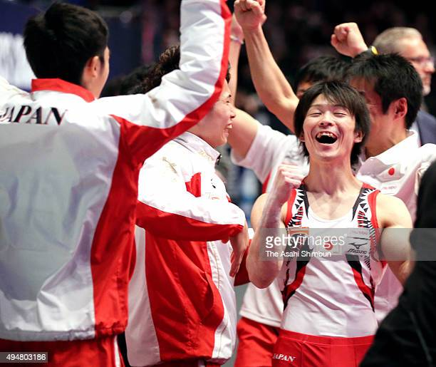 Kohei Uchimura and athletes of Japan celebrate winning the gold in the Men's Team during day six of World Artistic Gymnastics Championship at The SSE...