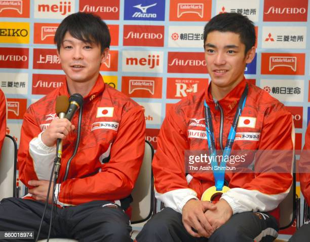 Kohei Uchimura and Kenzo Shirai attend a press conference on arrival at Narita International Airport on October 10 2017 in Narita Chiba Japan