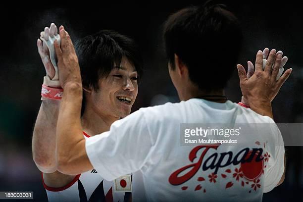 Kohei Uchimura of Japan celebrates after winning the Mens AllAround Final on Day Four of the Artistic Gymnastics World Championships Belgium 2013...