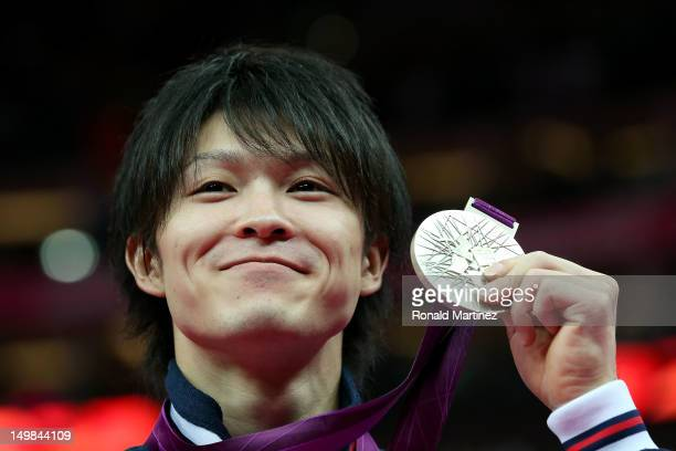 Kohei Uchimura of Japan celebrates with his silver medal during the medal ceremony for the Artistic Gymnastics Men's Floor Exercise final on Day 9 of...