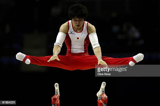 Kohei Uchimura of Japan competes in the parallel bars during the Artistic Gymnastics World Championships 2009 at O2 Arena on October 13 2009 in...