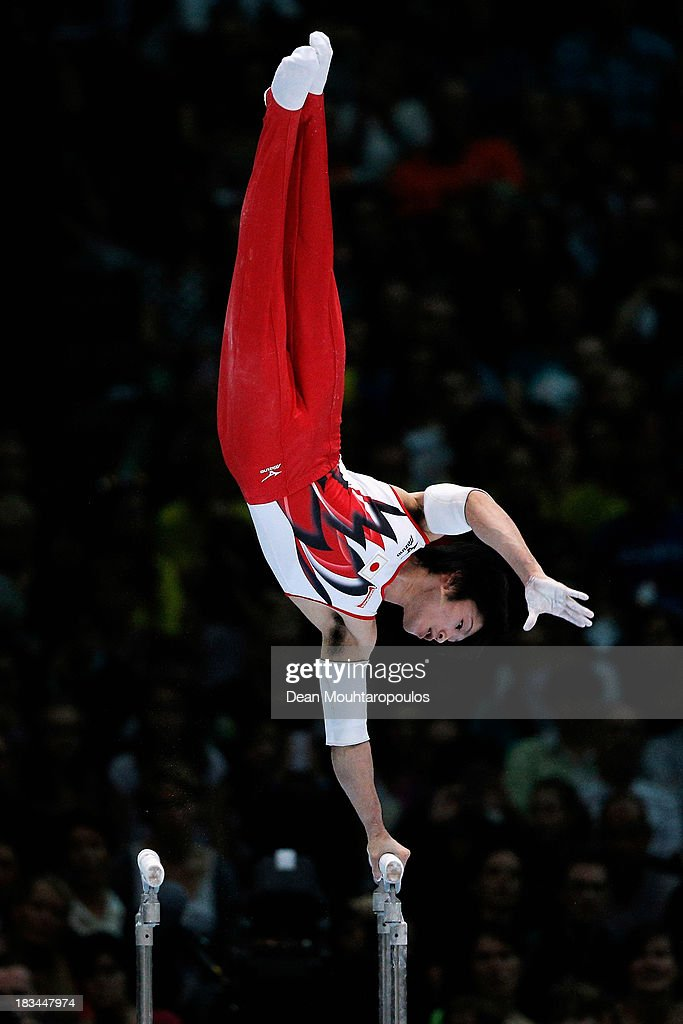<a gi-track='captionPersonalityLinkClicked' href=/galleries/search?phrase=Kohei+Uchimura&family=editorial&specificpeople=5481263 ng-click='$event.stopPropagation()'>Kohei Uchimura</a> of Japan competes in the Parallel Bars Final on Day Seven of the Artistic Gymnastics World Championships Belgium 2013 held at the Antwerp Sports Palace on October 6, 2013 in Antwerpen, Belgium.