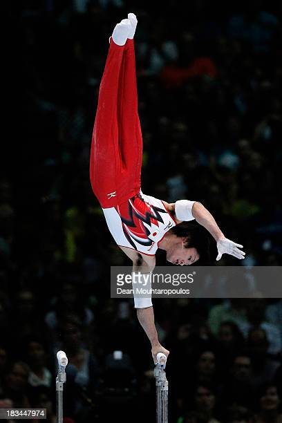 Kohei Uchimura of Japan competes in the Parallel Bars Final on Day Seven of the Artistic Gymnastics World Championships Belgium 2013 held at the...