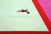 Kohei Uchimura of Japan competes on the floor in the Artistic Gymnastics Men's Floor Exercise final on Day 9 of the London 2012 Olympic Games at...