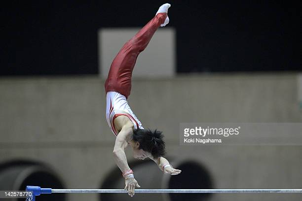 Kohei Uchimura of Japan competes on the High Bar during day two of the 66th All Japan Artistic Gymnastics All Around Championships at Yoyogi National...