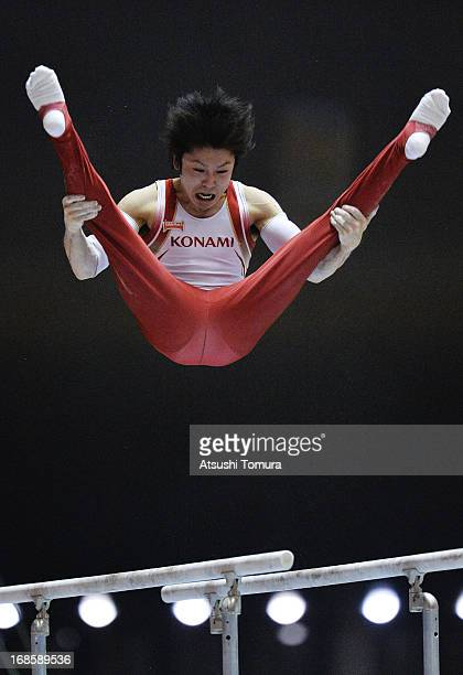 Kohei Uchimura of Japan competes on the parallel bars during day two of the 67th All Japan Artistic Gymnastics Individual All Around Championship at...