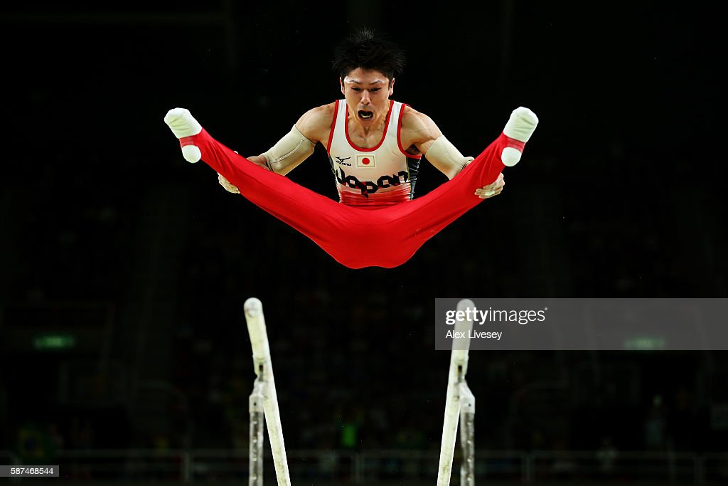 Kohei Uchimura of Japan competes on the parallel bars during the men's team final on Day 3 of the Rio 2016 Olympic Games at the Rio Olympic Arena on August 8, 2016 in Rio de Janeiro, Brazil.