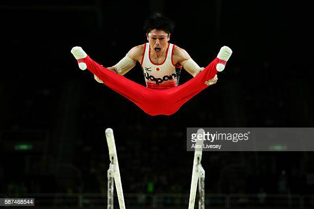 Kohei Uchimura of Japan competes on the parallel bars during the men's team final on Day 3 of the Rio 2016 Olympic Games at the Rio Olympic Arena on...