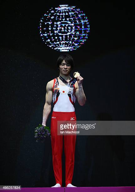 Kohei Uchimura of Japan poses with his gold medal from the High Bar during day ten of The World Artistic Gymnastics Championships at The SSE Hydro on...