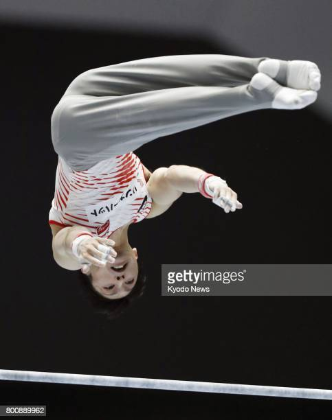 Kohei Uchimura twotime Olympic gymnastics individual allaround gold medalist performs his horizontal bar routine during the national apparatus...