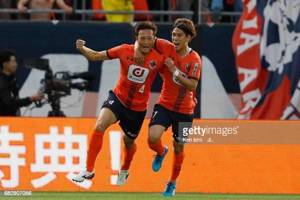 Kohei Yamakoshi celebrates with Ataru Esaka of Omiya Ardija after scoring during the JLeague J1 match between Omiya Ardija and Vegalta Sendai at Nack...