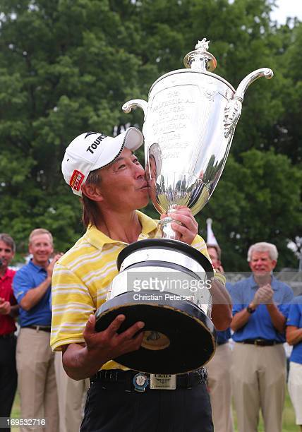 Kohki Idoki of Japan kisses the Alfred S Bourne Trophy in celebration after winning the Senior PGA Championship presented by KitchenAid at Bellerive...