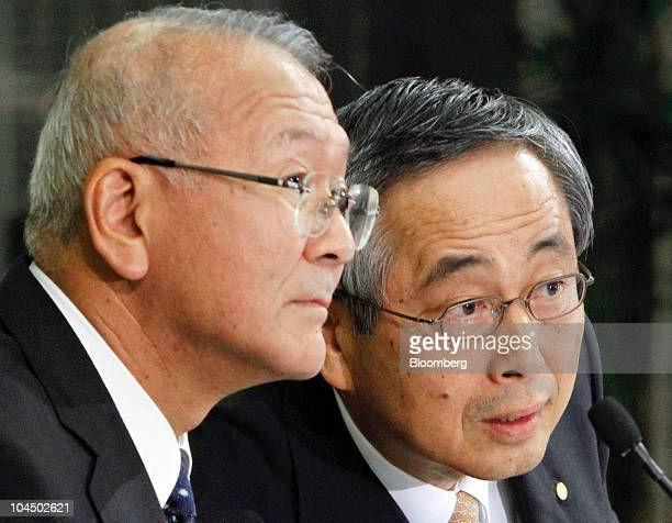 Koichi Ina president of Daihatsu Motor Co left and Yoichiro Ichimaru executive vice president of Toyota Motor Corp speak to the media during a joint...