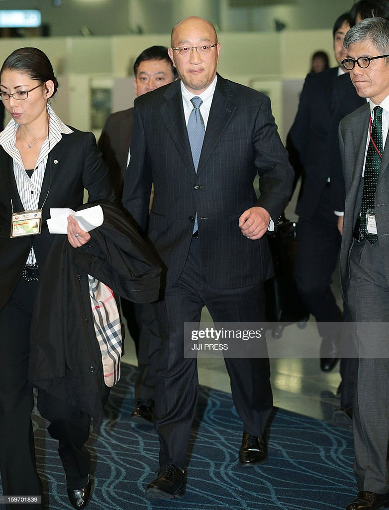 Koichi Kawana (C), president of Japan's plant builder JGC walks before journalists to head to Algeria at Haneda Airport in Tokyo on January 19, 2013. JGC said on January 19 it confirmed the safety of three of its Japanese staff and one Philippine employee in Algeria, with the whereabouts of dozens of other staff of various nationalities unknown. AFP PHOTO/Jiji Press JAPAN OUT