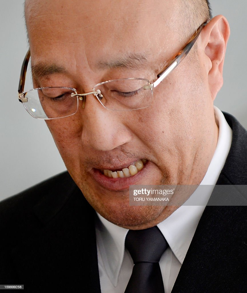 Koichi Kawana, president of Japan's plant construction company JGC, reacts as he answers questions during a press conference at the headquarters in Yokohama, suburban Tokyoon January 25, 2013 after a plane carrying seven survivors of the Algerian hostage crisis, along with nine of the country's ten dead, arrived back in a shell-shocked Japan on January 25. A plane carrying seven survivors of the Algerian hostage crisis, along with nine of the country's ten dead, arrived back in a shell-shocked Japan on January 25. AFP PHOTO/Toru YAMANAKA