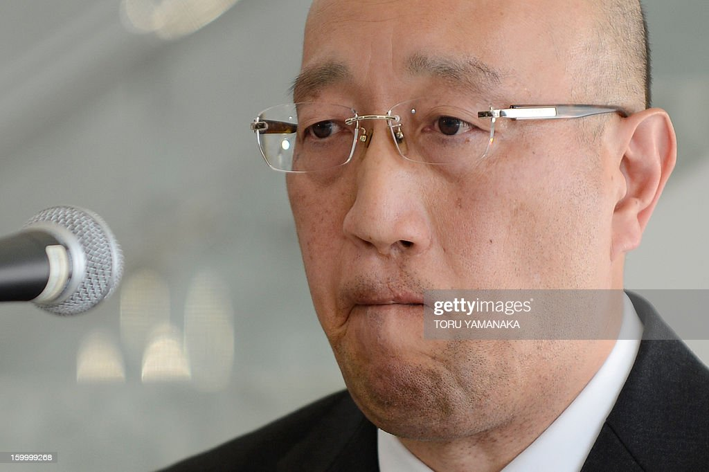 Koichi Kawana, president of Japan's plant construction company JGC, reacts as he answers questions during a press conference at the headquarters in Yokohama, suburban Tokyo on January 25, 2013 after a plane carrying seven survivors of the Algerian hostage crisis, along with nine of the country's ten dead, arrived back in a shell-shocked Japan on January 25. A plane carrying seven survivors of the Algerian hostage crisis, along with nine of the country's ten dead, arrived back in a shell-shocked Japan on January 25. AFP PHOTO/Toru YAMANAKA
