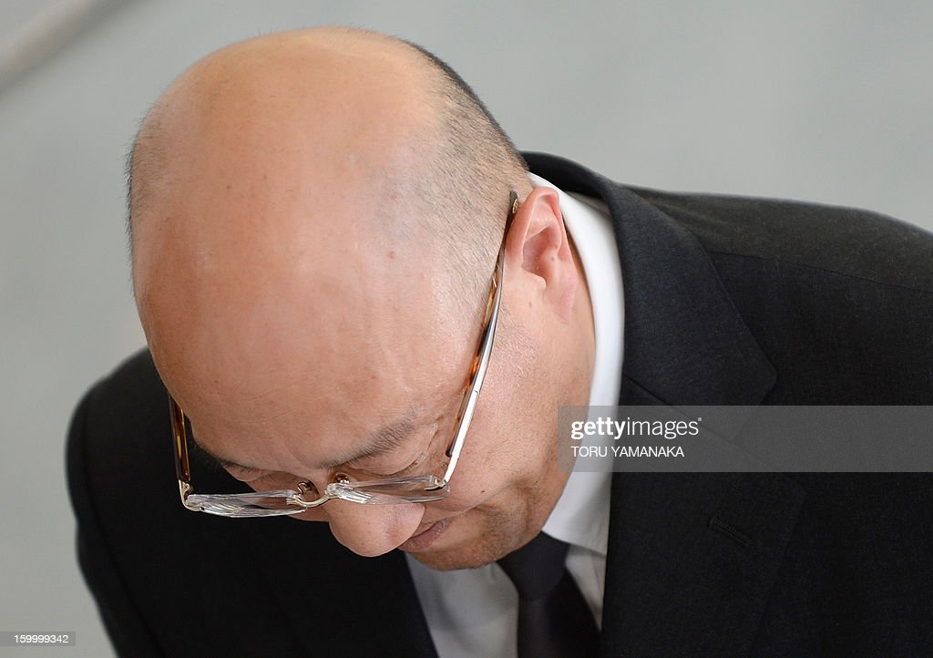 Koichi Kawana, president of Japan's plant construction company JGC, bows his head during a press conference at the headquarters in Yokohama, suburban Tokyoon January 25, 2013 after a plane carrying seven survivors of the Algerian hostage crisis, along with nine of the country's ten dead, arrived back in a shell-shocked Japan on January 25. A plane carrying seven survivors of the Algerian hostage crisis, along with nine of the country's ten dead, arrived back in a shell-shocked Japan on January 25. AFP PHOTO/Toru YAMANAKA