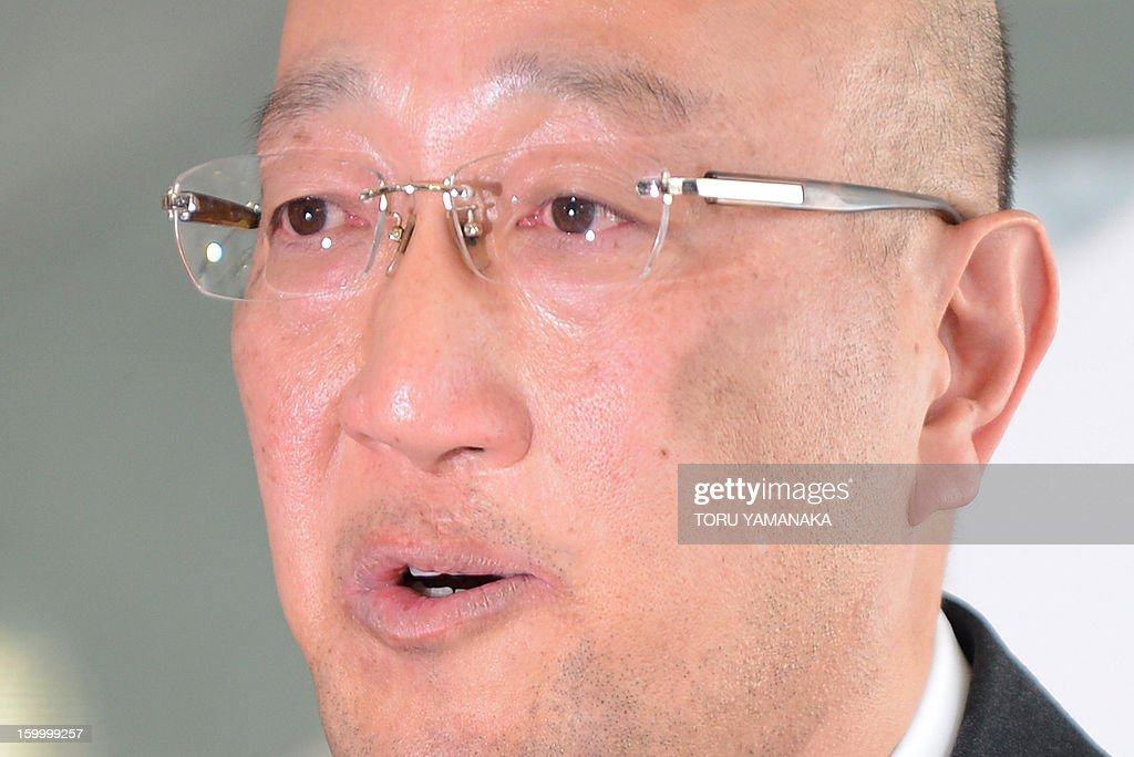 Koichi Kawana, president of Japan's plant construction company JGC, holds back tears as he answers questions during a press conference at the headquarters in Yokohama, suburban Tokyo on January 25, 2013 after a plane carrying seven survivors of the Algerian hostage crisis, along with nine of the country's ten dead, arrived back in a shell-shocked Japan on January 25. A plane carrying seven survivors of the Algerian hostage crisis, along with nine of the country's ten dead, arrived back in a shell-shocked Japan on January 25. AFP PHOTO/Toru YAMANAKA