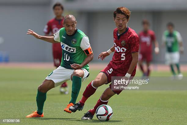 Koichi Maeda of FC Ryukyu and Naohiro Takahara of SC Sagamihara compete for the ball during the JLeague third division match between SC Sagamihara...