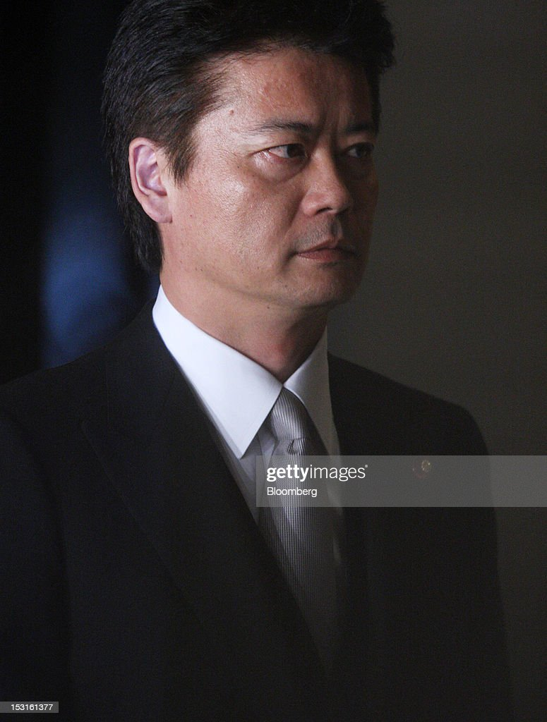 <a gi-track='captionPersonalityLinkClicked' href=/galleries/search?phrase=Koichiro+Gemba&family=editorial&specificpeople=7046304 ng-click='$event.stopPropagation()'>Koichiro Gemba</a>, Japan's re-appointed foreign minister, arrives at the prime minister's official residence in Tokyo, Japan, on Monday, Oct. 1, 2012. Japanese Prime Minister Yoshihiko Noda named 10 new ministers ahead of an election that may come by the end of the year. Photographer: Tomohiro Ohsumi/Bloomberg via Getty Images