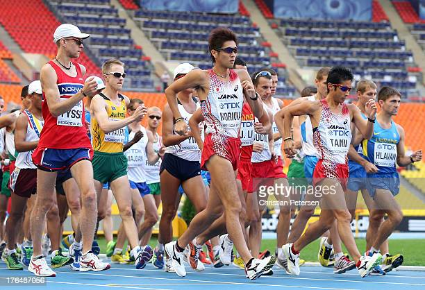 Koichiro Morioka of Japan and Takayuki Tanii of Japan compete in the Men's 50km Race Walk final during Day Five of the 14th IAAF World Athletics...