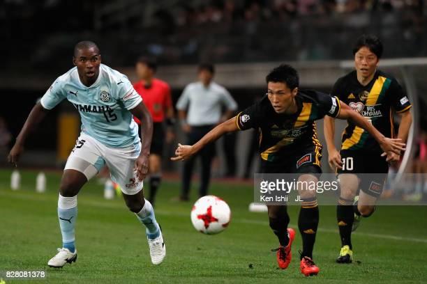 Koji Hachisuka of Vegalta Sendai and Adailton of Jubilo Iwata compete for the ball during the JLeague J1 match between Vegalta Sendai and Jubilo...