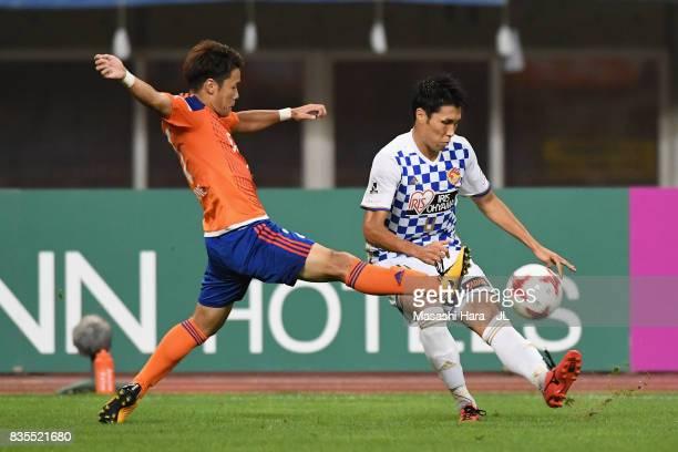 Koji Hachisuka of Vegalta Sendai and Yuto Horigome of Albirex Niigata compete for the ball during the JLeague J1 match between Albirex Niigata and...