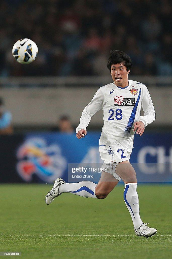 Koji Hachisuka of Vegalta Sendai controls the ball during the AFC Champions League match between Jiangsu Sainty and Vegalta Sendai at Nanjing Olympic Sports Center Stadium on March 12, 2013 in Nanjing, China.