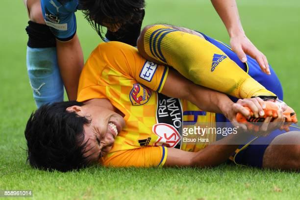 Koji Hachisuka of Vegalta Sendai lies injured during the JLeague Levain Cup semi final second leg match between Kawasaki Frontale and Vegalta Sendai...