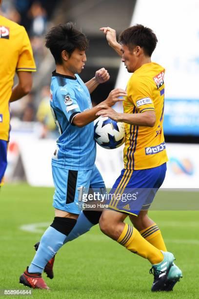 Koji Miyoshi of Kawasaki Frontale and Hiroaki Okuno of Vegalta Sendai compete for the ball during the JLeague Levain Cup semi final second leg match...