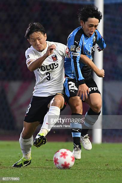 Koji Miyoshi of Kawasaki Frontale and Tomoya Ugajin of Urawa Red Diamonds compete for the ball during the 96th Emperor's Cup fourth round match...