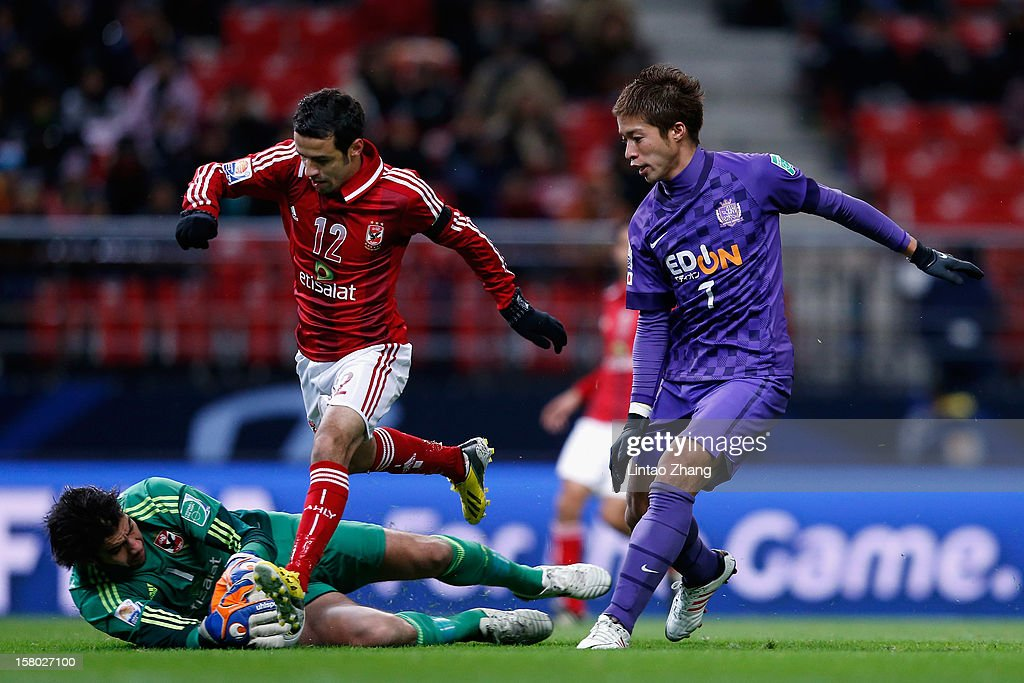 Koji Morisaki (R) of Sanfrecce Hiroshima challenges with Ahmed Kenawi and Sherif Ekramy (L) of Al-Ahly SC during the FIFA Club World Cup Quarter Final match between Sanfrecce Hiroshima and Al-Ahly SC at Toyota Stadium on December 9, 2012 in Toyota, Japan.