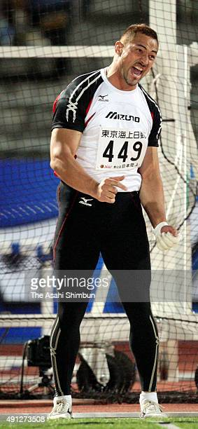 Koji Murofushi reacts after competing in the Men's Hammer Throw during day two of the 92nd Japan Track and Field Championships at Todoroki Stadium on...