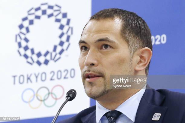 Koji Murofushi sports director of the 2020 Tokyo Olympics and Paralympics organizing committee attends a press conference on Oct 4 in Tokyo as a...