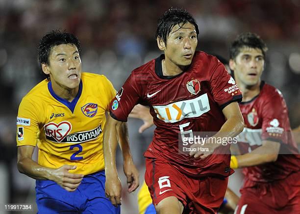 Koji Nakata of Kashima Antlers and Jiro Kamata of Vegalta Sendai compete for the ball during the JLeague match between Kashima Antlers and Vegalta...