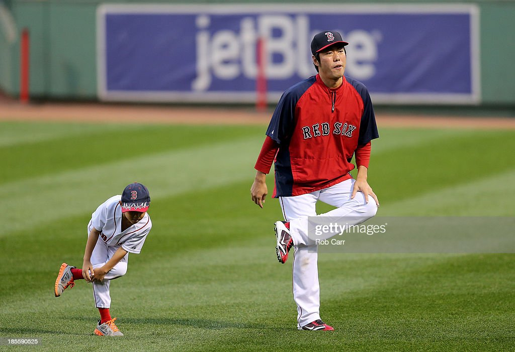 <a gi-track='captionPersonalityLinkClicked' href=/galleries/search?phrase=Koji+Uehara&family=editorial&specificpeople=801278 ng-click='$event.stopPropagation()'>Koji Uehara</a> (R) #19 of the Boston Red Sox warms up with his son Kazuma during team workout in the 2013 World Series Media Day at Fenway Park on October 22, 2013 in Boston, Massachusetts. The Red Sox host the Cardinals in Game 1 on October 23, 2013.