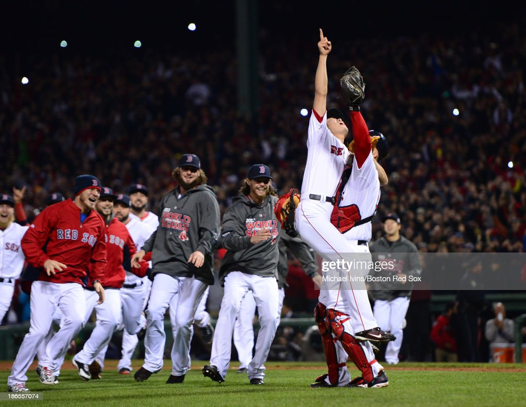 <a gi-track='captionPersonalityLinkClicked' href=/galleries/search?phrase=Koji+Uehara&family=editorial&specificpeople=801278 ng-click='$event.stopPropagation()'>Koji Uehara</a> #19 and <a gi-track='captionPersonalityLinkClicked' href=/galleries/search?phrase=David+Ross+-+Baseball+Player&family=editorial&specificpeople=210843 ng-click='$event.stopPropagation()'>David Ross</a> #3 of the Boston Red Sox celebrate after defeating the St. Louis Cardinals 6-1 in Game Six and winning the World Series on October 30, 2013 at Fenway Park in Boston, Massachusetts.
