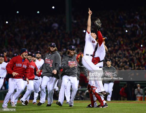 Koji Uehara and David Ross of the Boston Red Sox celebrate after defeating the St Louis Cardinals 61 in Game Six and winning the World Series on...